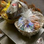 Table of wrapped Thanksgiving baskets