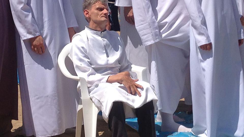 Vadim preparing to be baptized