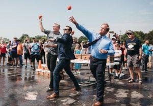 president john stumbo, mayor joe begeny, director for development andrew bowsher throwing tomatoes at the old k-mart building in reynoldsburg ohio