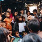 international worker syna teaching cambodian children
